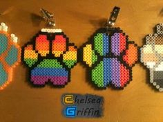 These rainbow paw prints would look great stitched on to plastic canvas...