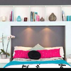 Bookshelf headboard. Love the lights above the bed