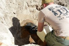 Explosive Ordnance Disposal Technician 2nd Class Anthony Yockey, assigned to Explosive Ordnance Disposal Mobile Unit (EODMU) 5, Detachment Marianas (Det Mari), pours phlegmatizer into an unexploded World War II-era sea mine after completing a render safe procedure. Phlegmatizer is a material added to an explosive to make it less susceptible to detonation, therefore more stable and safer to handle and transport. | #AmericasNavy #USNavy #Navy navy.com