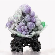 LAVENDER JADEITE AND JADEITE 'PROSPERITY' CARVING, Of celadon tone suffused with intense lavender and patches of apple green, carved as a ba...
