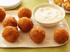 Buffalo Chicken Cheese Balls : Rotisserie chicken and sharp cheddar cheese are the key ingredients in this irresistible fried snack. A blue cheese and mayo dip spiked with hot sauce goes on the side.