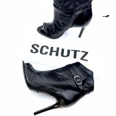 """SCHUTZ Quetlin Bootie Perforated bootie with a scalloped upper, open toe, belted detail, slim heel Approximate measurements: heel 4.25"""", platform 0.25"""" Shaft height from arch 7."""", Boot opening 11.5"""" around Fit: 0.91 Country of origin: Brazil Material: Leather Lining: Leather Insole: Leather, Sole: Leather SCHUTZ Shoes Ankle Boots & Booties"""