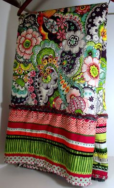 """Love the idea of one large center, random pieces on the outside for a border! Modern Quilt Blanket """"Kaboom"""" Alexander Henry designer fabric. , via Etsy."""