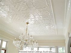 Using pressed metal ceilings to create a natural 'boundary' for an open plan room