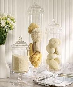 Bath salts, natural sponges/loofahs, and natural shaded soaps for bathroom apothecary jars.