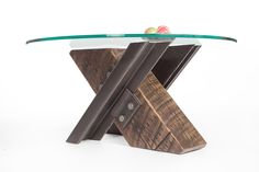 Reclaimed steel and timber coffee table X-shaped with round glass top from Rail Yard Studios