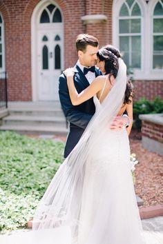 Romantic wedding featuring a dress by Essense of Australia
