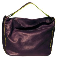 A rich, luxurious carryall that packs a practical punch. The Susan Bag features beautifully textured leather on the outside and interior organization sections for your accessories on the inside. Fully lined, its brightly colored ultra suede makes finding your keys a piece of cake, while oversized metal feet will protect against damp and rough surfaces.