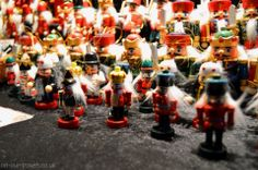 Little wooden soldiers at a stall.
