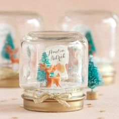 DIY mini snow globes make perfect gifts for a winter wedding.