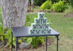 Minecraft Bowling.  Easy DIY made with floral cubes, then glued cardstock creeper face cutouts.  Kids knocked down the creepers with either boulders (bean bags) or bow and arrows.