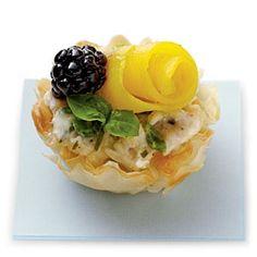 Beautiful .. looks like thin slice of mango w/ blackberry chicken salad phyllo cup