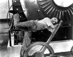 Charlie Chaplin plays a factory worker.  His job is to mindlessly tighten bolts on a conveyor belt assembly line.  The work is fast paced and makes for some great gags, some of the most memorable scenes in the film.