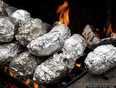 Tinfoil-Campfire--'Tis the season to cook outside. If you're camping or just spending an evening around the fire pit, put food in a foil covering and then stick it on coals on the side of the fire. Kids can see their food cooking in real time and can help by turning over the foil with a stick.
