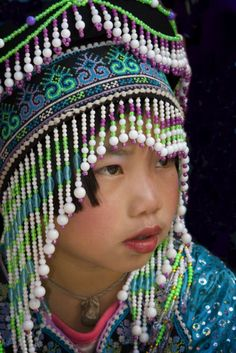 Thailand | Portrait of a young girl in traditional dress. Chiang Mai | ©Al Meilan