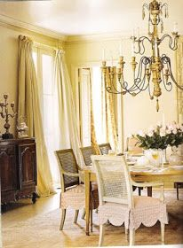 Beautiful scalloped edged slipcovers and puddled draperies
