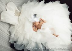 Baby Olivia in mommy's wedding dress... how cool is this idea?!