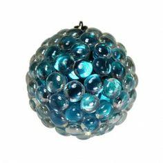 Glass pebbles glued on an ornament with a glue gun.