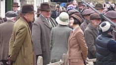 The cast of Downton Abbey including Michelle Dockery and Hugh Bonneville have been seen filming a market scene for series six of the hit show