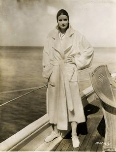 Greta Garbo- more than 50 years ahead of her time, Greta often wore sneakers with tailored overcoats...here she's strolling a cruise ship.