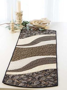 "An easy project to whip up for the holidays! This table runner and place mat pattern is perfect for all those large-scale prints that have been giving you that come-hither look. Quick-to-stitch and super trendy, the finished project makes for a great gift for any special person in your life. You can jazz up the finished look by add some extra stitches here and there, embellishments, and your favorite fabrics. Finished sizes: Table runner: 15"" x 47"" Place mats: 14"" x 18 1/2"" each"