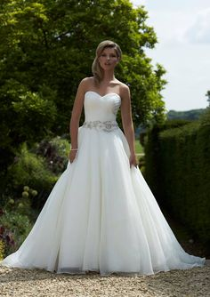 This to-die-for design, Artemis!  How much do you love that full, organza skirt and statement belt?