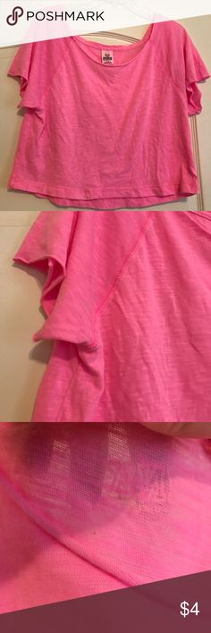 PINK Crop Top Size S This adorable bright pink crop top is heavily loved but still has a lot of life in it! Please note the pin sized holes on the back of the shirt and a few on the sides (as pictured, not noticeable upon first glance). The vivid color of this top makes it fun to wear to bed or as a coverup! Grab this treasure today! PINK Victoria's Secret Tops Crop Tops