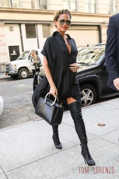 Chrissy Teigen with The Row Classic Tote.  She is winning pregnancy style.