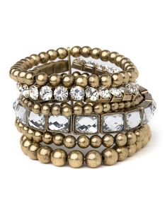 $24 When you're looking to add a little gypsy-chic to your glamour, bronze is the way to go. And with these cool bangles, you'll be set—they include everything from bold beads to sparkling oversized crystals.