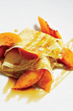 Pastry chef Nicole Krasinski adds sherry vinegar to make a tangy caramel sauce, which she drizzles over peach wedges and buttery-crisp crêpes. Apricots would also work here.#peachrecipes #peaches #brunch