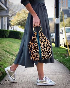 Take a walk on the wild side. 🐆 Tap to shop our best-selling 'Marilyn' Ring Tote ❤️ handmade with love by brave refugee women rebuilding their lives in the U. Leather Bags Handmade, Handmade Bags, Fashion Bags, Fashion Outfits, Womens Fashion, Sacs Design, Boho Bags, Patchwork Bags, Purses And Handbags
