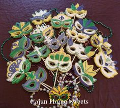 Mardi gras decorated sugar cookies. Royal icing. Yellow, gold, purple, green, white. Mask. Cookie pops.