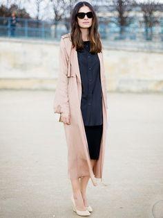 Silky long coat draped over a LBD
