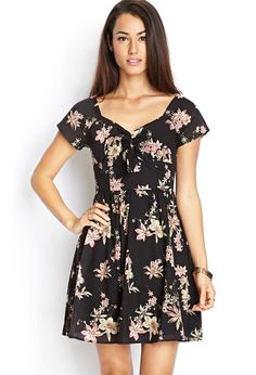 Love 21 - A short sleeved woven dress featuring a floral print and knotted accent. . Concealed bac...