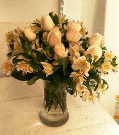 These crème dozen roses are brought to life by white and yellow alstromeria! Makes a simple dozen roses becoming even more stunning!!!