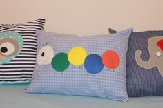 A personal favorite from my Etsy shop https://www.etsy.com/il-en/listing/252394620/caterpillar-baby-pillow-caterpillar