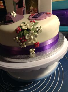 Flowers on purple shoe cake
