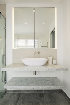 Harcourt Road by Ardesia Design. Cool storage idea. Warm grey tones in ensuite bathroom #bathroom #ideas #grey #tiles #micromosaic #carrara #marble #top #countertop #minimalistic #modern #shower #blinds #white #storage #led #cabinet