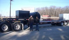 Chris, the Shop Foreman and Tommy, the Assistant Shop Foreman with the 30 ton drop deck trailer.