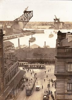 Circular Quay in Sydney in 1930 facing the harbour.In the background is the construction of the Sydney Harbour Bridge. Perth, Brisbane, Sydney City, Sydney Harbour Bridge, Sydney Area, Harbor Bridge, Melbourne, Cairns, Travel Posters