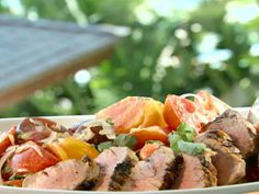 Get Grilled Pork Tenderloin with Spicy Chile-Coconut Tomato Salad Recipe from Food Network