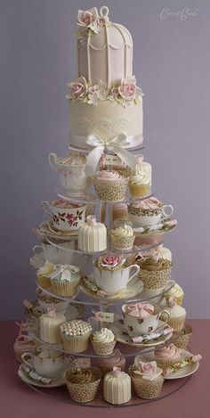 Birdcage Wedding Cake- I that there's more than one cupcake design in the tower