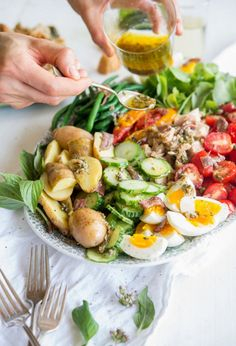 Salade Nicoise - Potatoes, soft boiled eggs, tuna, a zest dressing, beans....power meal with class.