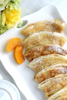 Peaches and Cream Cheese Crepes begins with a simple crepe, then filled with a sweetened cream cheese mixture, fresh sliced peaches, a sprinkling of brown sugar and a pat of butter that is then baked until warmed through. A dusting of confectioners' sugar Crepes And Waffles, Savory Crepes, Pancakes, Crepes Nutella, Köstliche Desserts, Delicious Desserts, Dessert Recipes, Yummy Food, Pancake Recipes