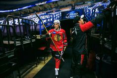 Andrew Shaw walks to the ice at Scottrade Center before Wednesday's morning skate. #Game1 #Blackhawks