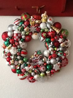 Traditional Christmas-themed glass ornament wreath...made this one for Ron & Kim.
