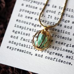 Pet Rock necklace. Check out geometric packaging