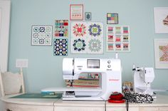 Thimbleblossoms Sewing room. I like the little quilt square arrangement over the sewing machine.