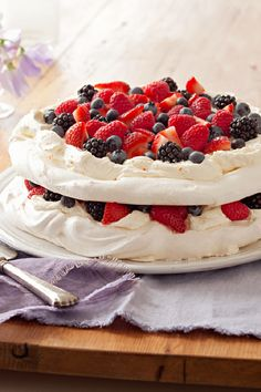 Layered Berry Pavlova – Layers of sweetened cream cheese and mixed berries—including strawberries, blueberries and raspberries—are layered with meringue in this yummy dessert recipe.