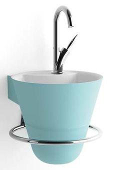 Cône de Decotec est un lave-mains en solid surface à la ligne très harmonieuse et qui ne laisse voir que sa jolie forme de cône.